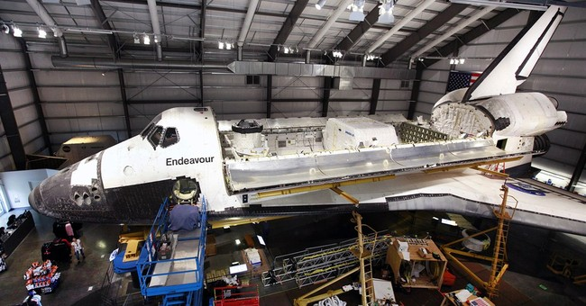 Retired shuttle Endeavour exhibit closer to launch