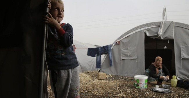 Kurds struggle to defend besieged Syrian town