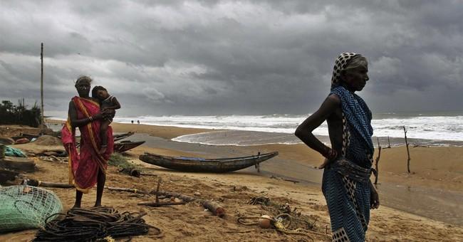 Cyclone in India kills 8 as typhoon hits Japan