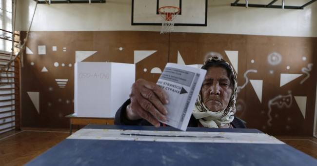 Bosnians elect new leaders amid old divisions