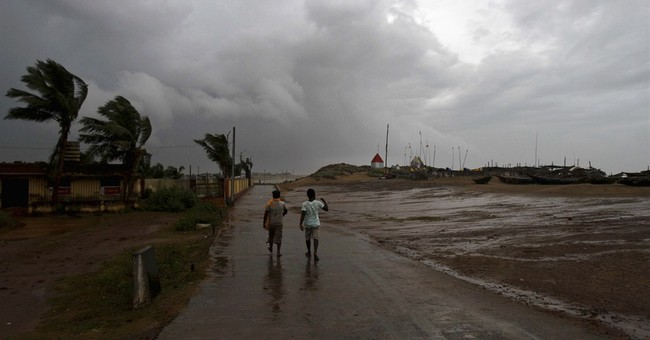Workers clear debris after Indian cyclone kills 24