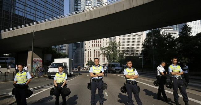 Hong Kong police trim pro-democracy protest zone