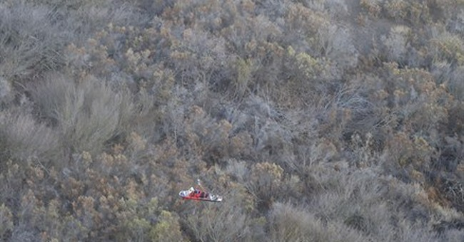 Woman rescued after vehicle rolls down embankment