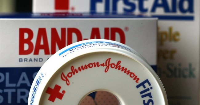 J&J hikes 2014 forecast for a third time
