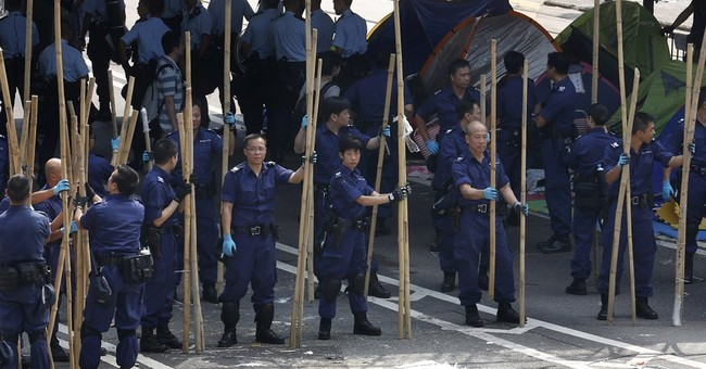 Hong Kong police drag activists away, clear tunnel
