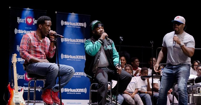 Boyz II Men return to Philly high school for show