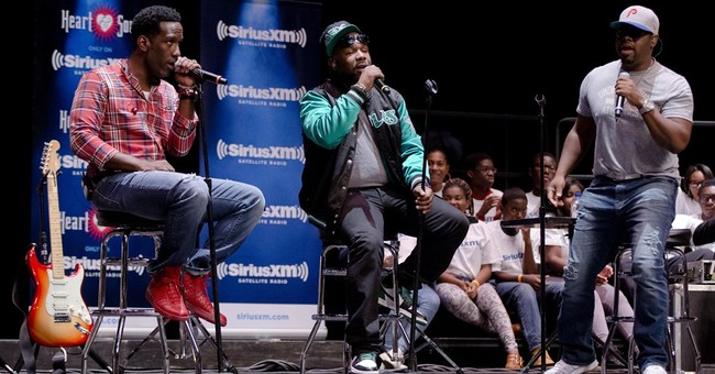 Boyz II Men return to Philly high school for show