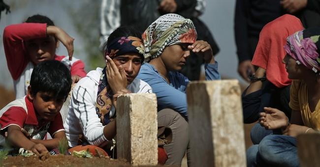 AP PHOTOS: Kurds bury killed female fighters