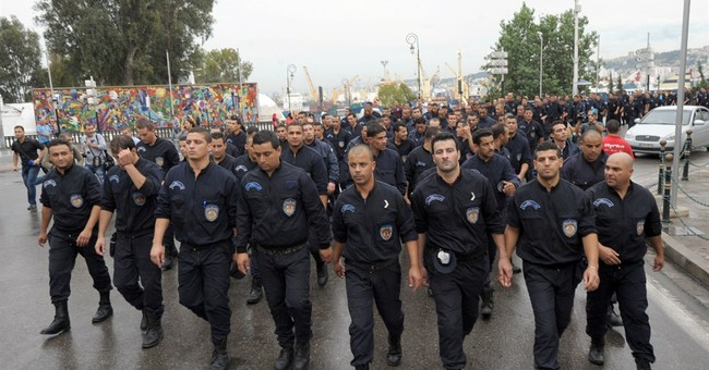 Algerian police march on president's office