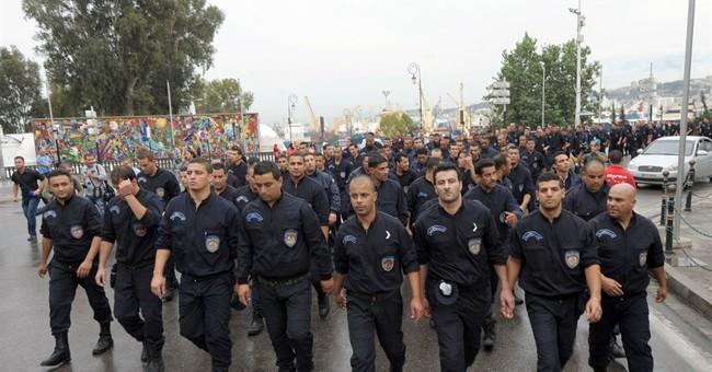 Algerian police march on president's office
