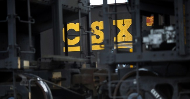 CSX 3Q profit rises 12 percent, tops estimates