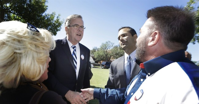 In Texas, Bush father and son hit campaign trial