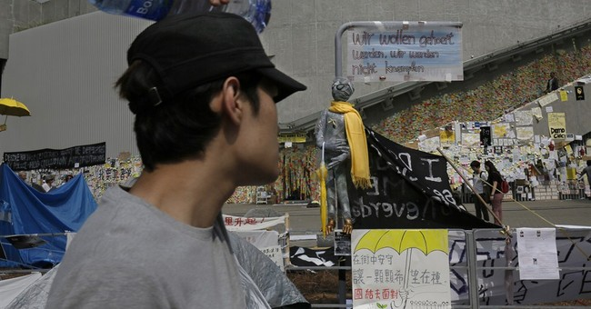 Hong Kong police hold back from removing barriers
