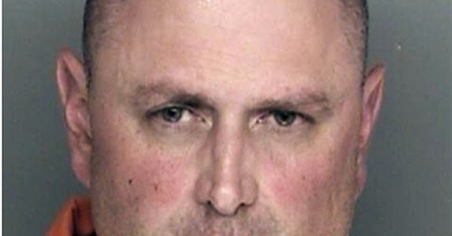 Man charged in killings of 4 family members, dog