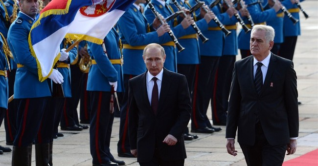 Putin cheered in Serbia, seeks pipeline backing