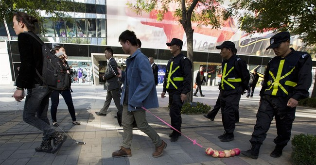 Image of Asia: Walking apples and a phone in China