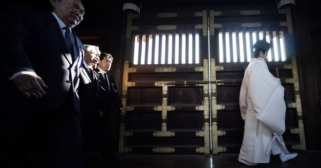 Japan PM sends offerings to war shrine