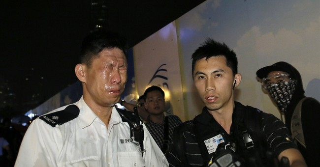 Hong Kong police clear smaller protest zone