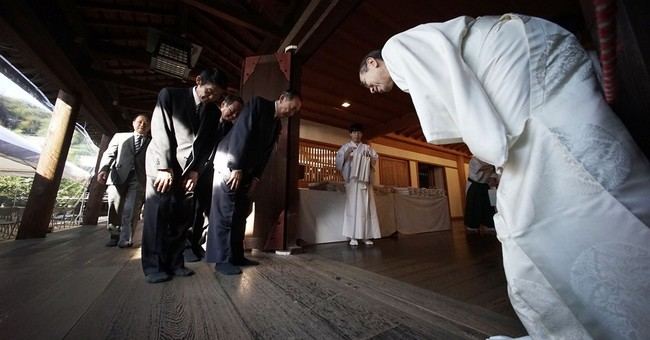 Japan PM sends offerings to war shrine