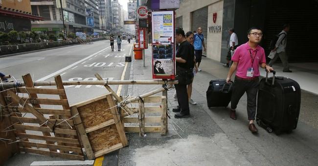 Fresh scuffles between Hong Kong police, activists