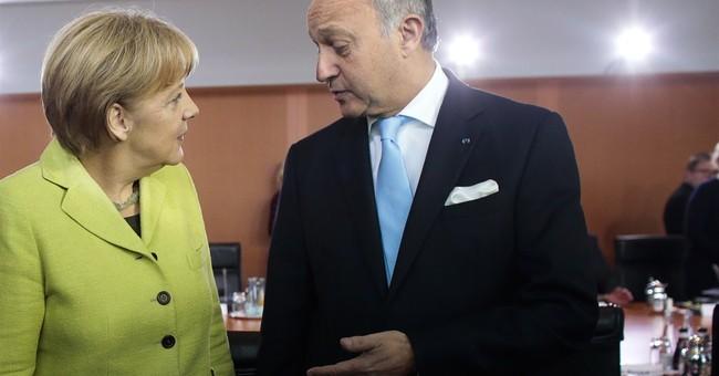 Germany's Merkel warns France over budget deficit