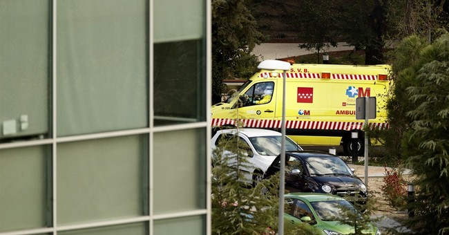 Spain tests 4 with fever for Ebola, isolates jet