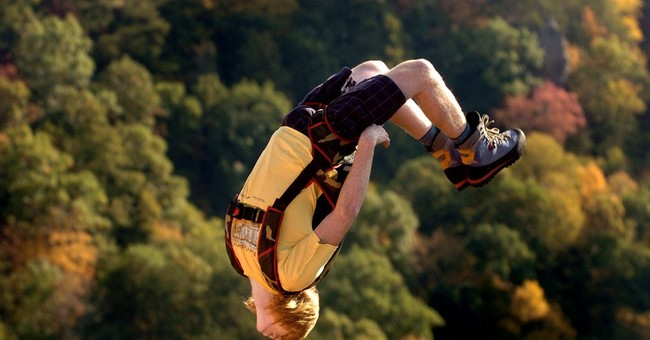 Wheelchair parachutist rolling off 876-foot bridge