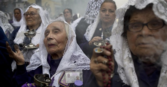 AP PHOTOS: Catholics venerate Lima's patron saint