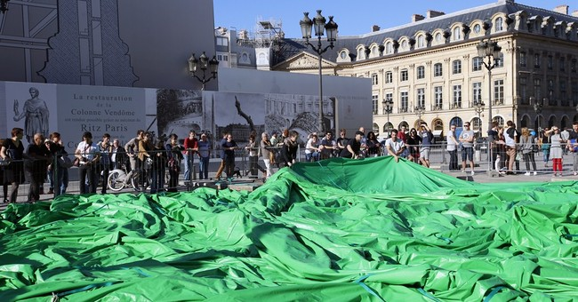 Paris sculpture removed after vandals strike