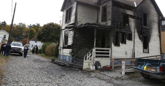 Fire that killed 6 began downstairs; cause unclear