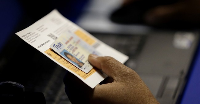 Justices allow Texas use of new voter ID law