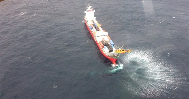 Tug towing disabled Russian container ship to port