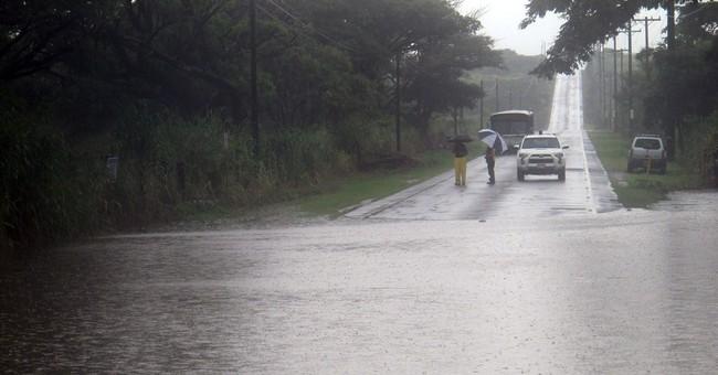 Hawaii hit by winds, rain as hurricane veers west
