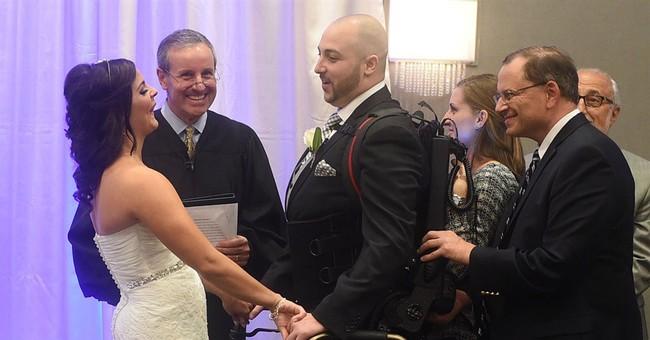 Robotic device helps paralyzed groom walk aisle