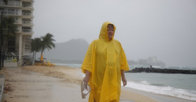 Hawaii rides out storm, but remote islands at risk
