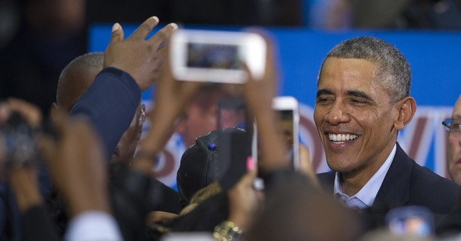 At rallies, Obama casts 2014 as key for his legacy