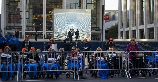 Standing ovation at Met Opera despite protest