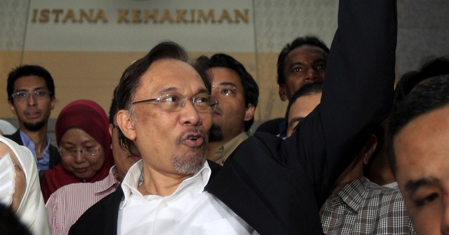 Opposition leader Anwar expects to be jailed again