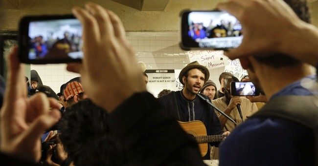 NYC police looking into arrest of subway performer