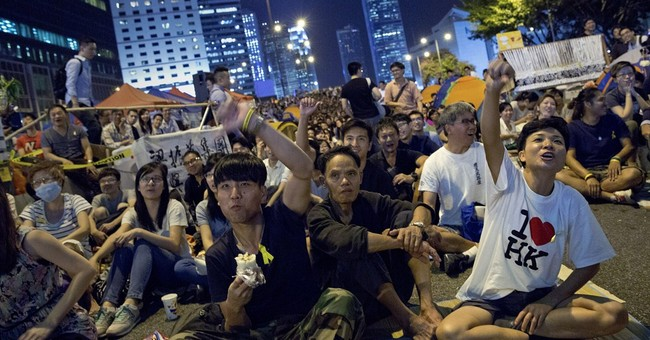 Image of Asia: Watching talks in Hong Kong streets
