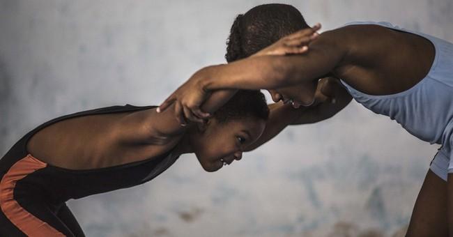 AP Photos: Children learn wrestling in Old Havana