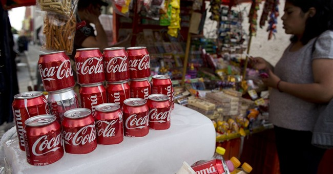 Coke to slash costs as soda sales remain flat