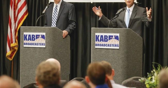 Brownback cites Wichita murder case in last debate