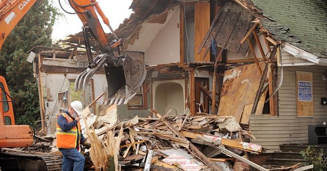 Crews tearing down home where babies' bodies found