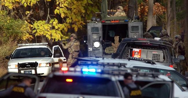 Schools scoured in search for ambush suspect