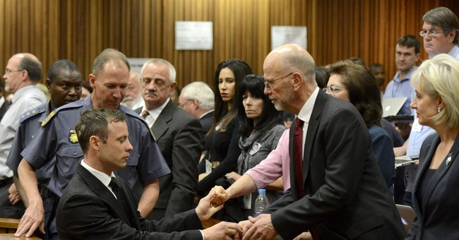 Pistorius spends first night in single jail cell