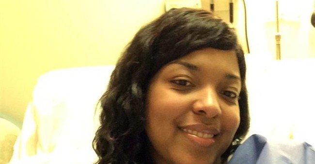 Family: Doctors don't detect Ebola in nurse's body