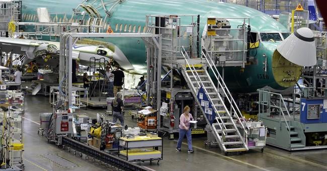 Passenger jets push Boeing's profit up 18 percent