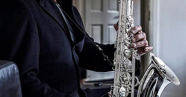 Sax player behind 'Baker Street' solo dies at 60