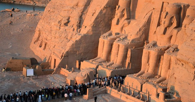 Tourists watch solar alignment in Egypt temple